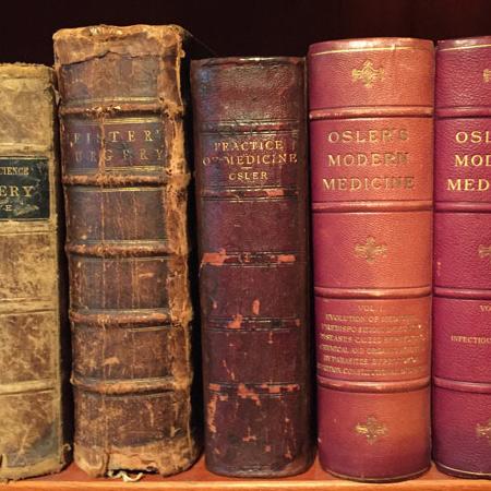 rare medical books on bookshelf
