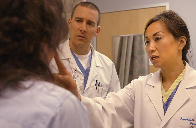 Josephine and Matt treating a patient