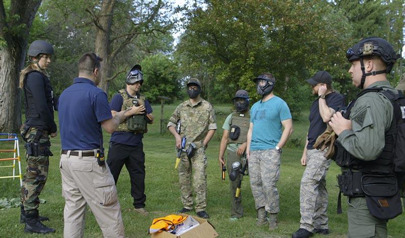 Emergency medicine medics gather around John for instructions
