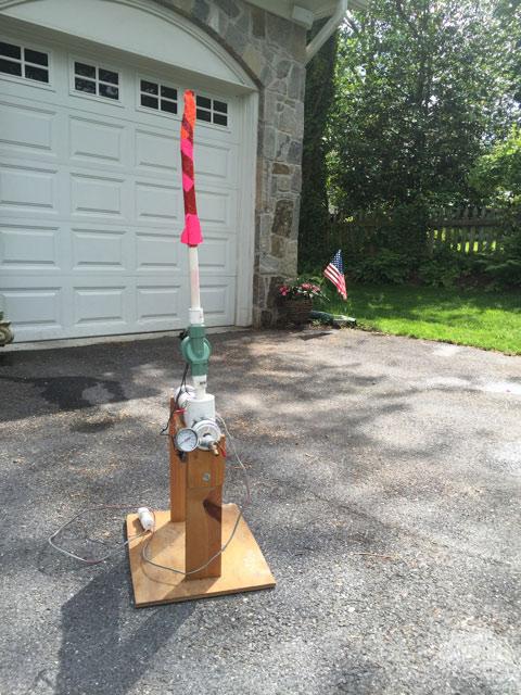 Homemade rocket launcher in driveway