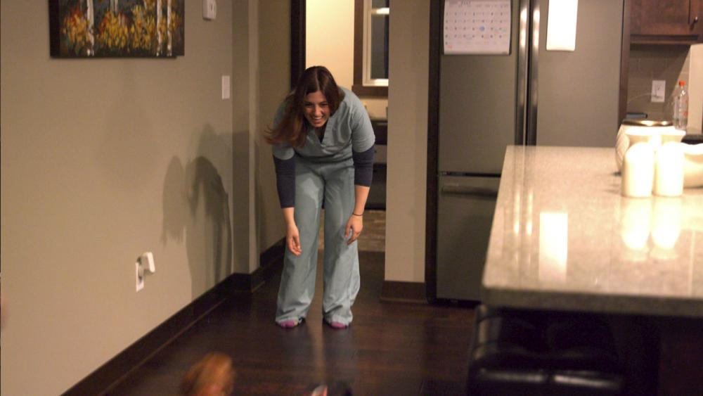 Sara comes home from work and greets her dogs.