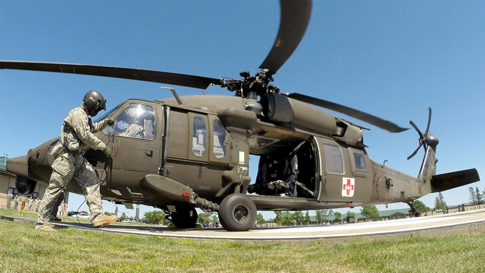 Black Hawk helicopter on landing pad.