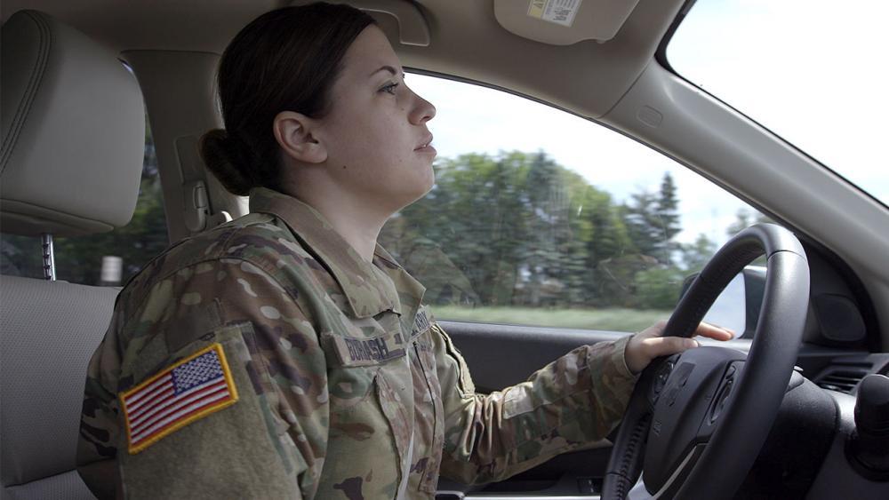 Sara in car driving.