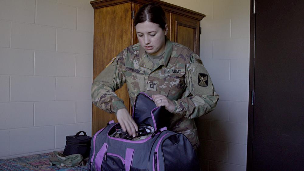 Sara unpacking her bag.