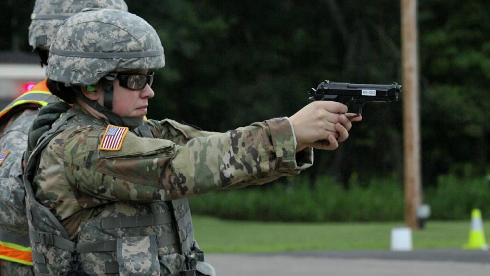 Sara pointing a gun toward a target