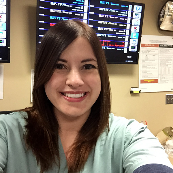 Selfie photo of sara in front of medical screens at hospital