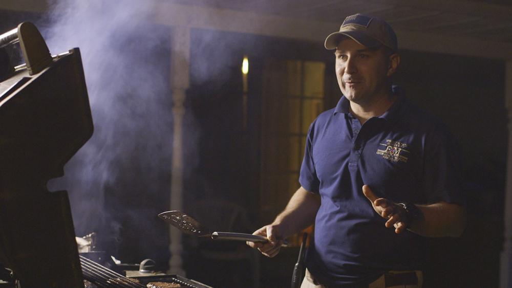 John grilling hamburgers
