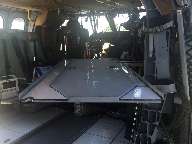 Litter set up inside a black hawk helicopter.