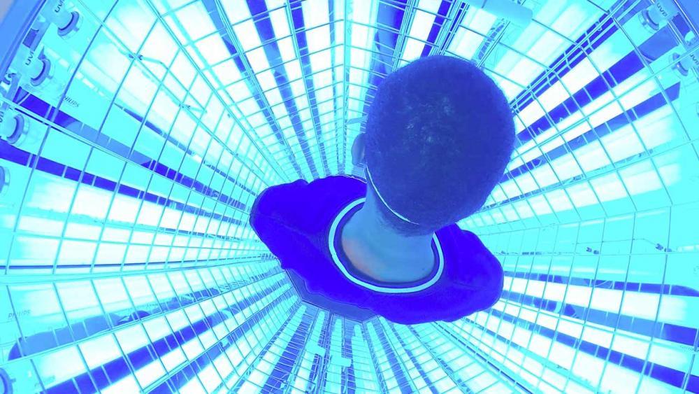 Patient inside the light box