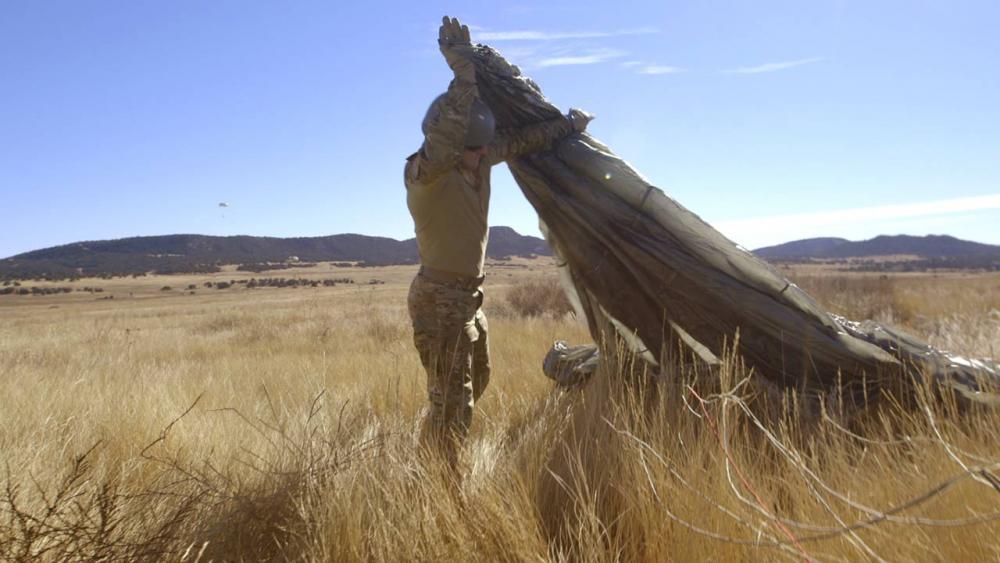 Hunter folds his parachute