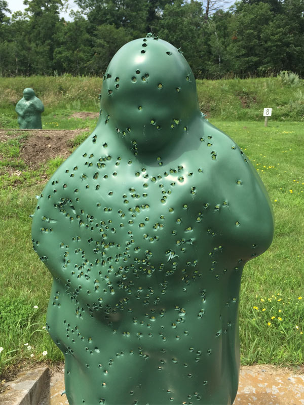 Close up of green, man-shaped target