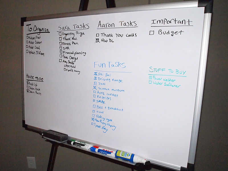 Whiteboard filled with to-do tasks