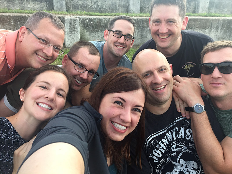 Photo of sara with several friends