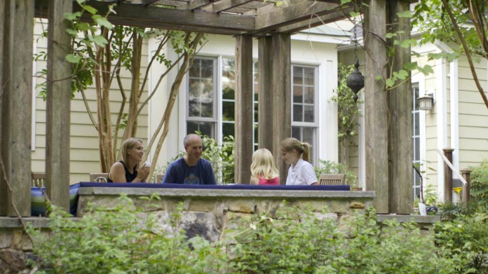 The Forsberg family eating dinner on outdoor patio