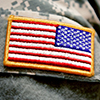 A close-up of a patch on the uniform of a military medical officer.
