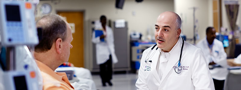 A military physician answers a patient's questions.