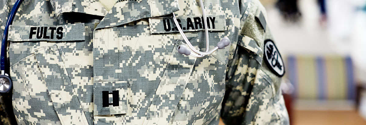 A close-up on the uniform of a military medical officer.